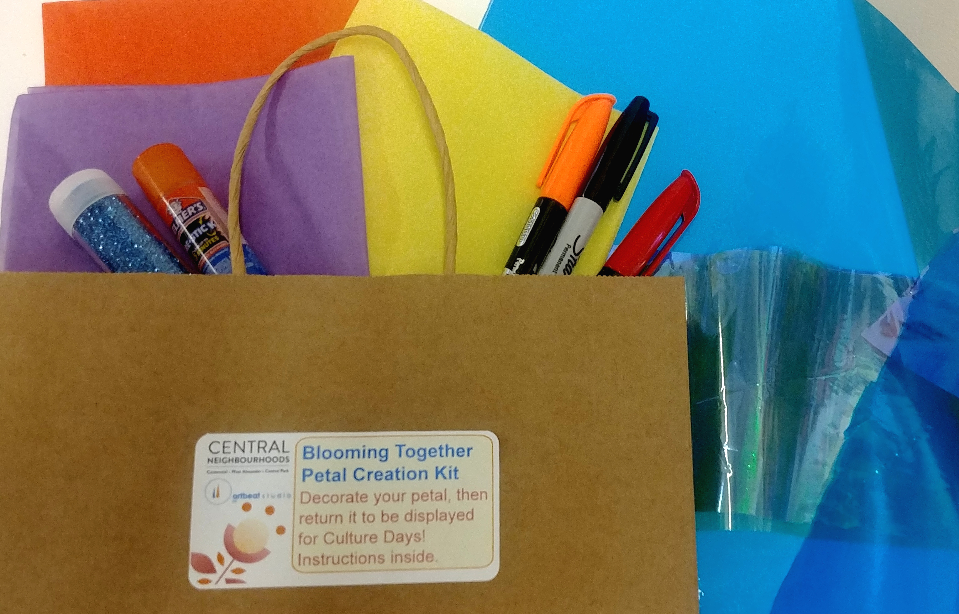 Paper bag with art supplies